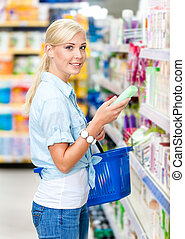 Half length portrait of girl at the market choosing...