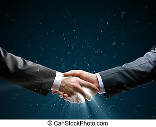 Close up of successful deal - Businessman shaking hand to...