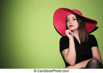 Young woman wearing pink hat - Portrait of a young woman...