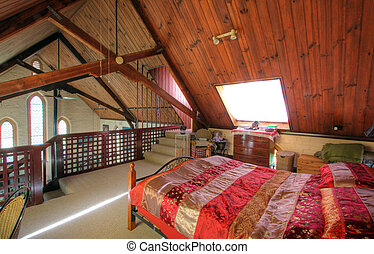 Stylish king size bedroom in a Church converted into a house