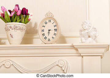 Old mantel clock with a candlestick in the form of an Angel