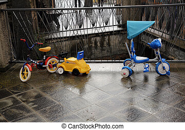 Tricycles parked on pedestrian square in Riomaggiore,...