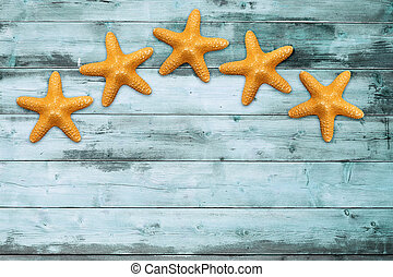 sea stars on a turquoise board - five sea stars on a...