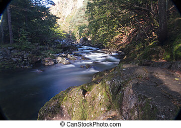 Aberglaslyn Pass - River Glaslyn running through alpine...