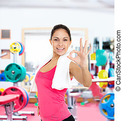Woman gym show hand finger gesture sport - Woman in gym...