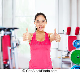 sport fitness woman smile show thumb up gym