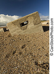 World War Two Pillbox sinking into pebbled beach, Chesil...