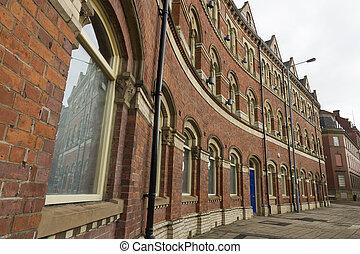 Victorian red brick three storey row in street - Exchange...