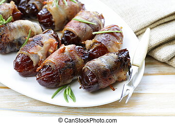 appetizer delicacy dates wrapped in bacon and fried