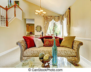 Beautiful antique sofa with colorful pillows. House inteior....