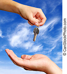 hands with key - Hands with key on a background sky