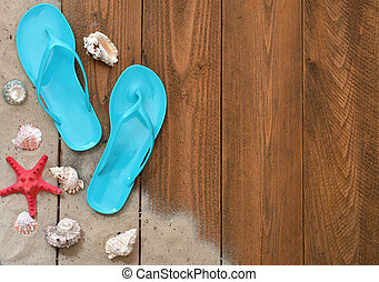 Vacation Concept Blue Flip-flops with red starfish on wooden...
