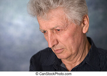 portrait of an thinking elderly man - close-up portrait of...