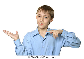 Young smiling boy pointing something isolated on white...