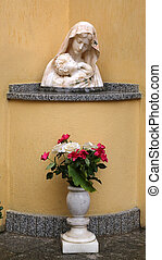 The statue of Madonna with the Child in front of the Church...