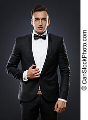 business man in suit on a dark background