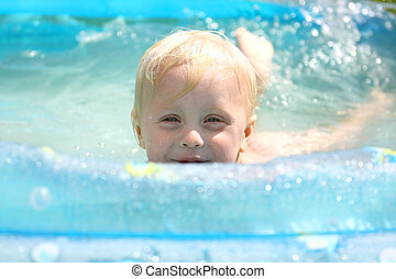 Happy Baby Playing in Swimming Pool