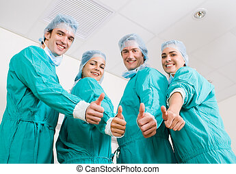 Medical doctors team - A group young doctors puts hands...