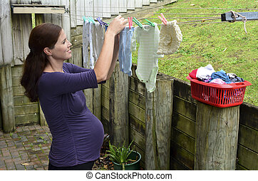 Pregnancy - pregnant woman housework - Pregnant housewife...