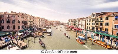 Gondola with gondolier and vaporetto station