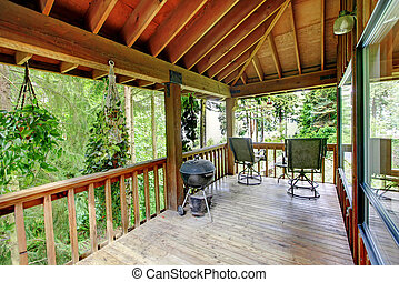 Walkout deck in log cabin house - Wooden walkout deck with...