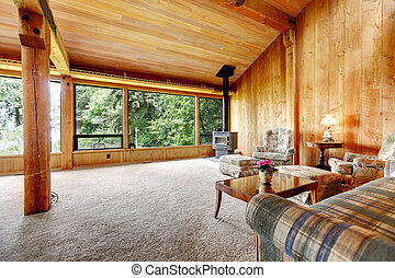 Log cabin living room - Spacious log cabin living room with...