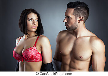 Image of young sexy partners looking at each other -...