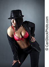 Hot busty brunette posing in costume for dancing - Portrait...