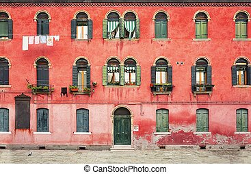 Two-storey house with red facade - Duplex colored house on...