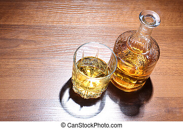 Whiskey glass on table - Luxury old whiskey glass on wood...