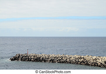 Stone Pier on the blue Atlantic Ocean Water