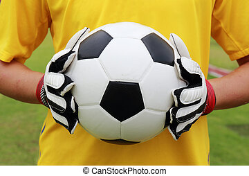 soccer player with ball in his hand