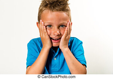 Surprised boy - Caucasian boy with a silly face Studio shot...