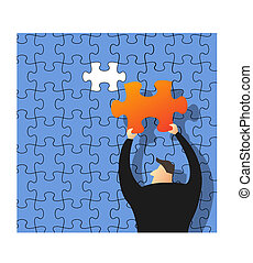 Businessman making a puzzle on the wall, business concept