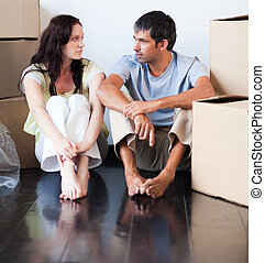 Couple talking about thir new house after moving
