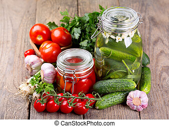 canned tomatoes and cucumbers with fresh vegetables