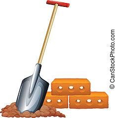 A shovel and bricks