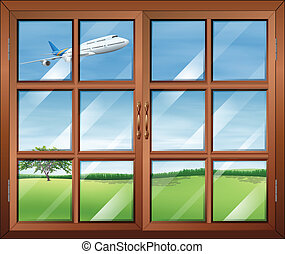 A window with a view of the airplane in the sky