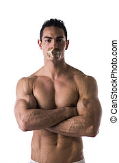 Muscular shirtless young man with duct tape on mouth cannot...
