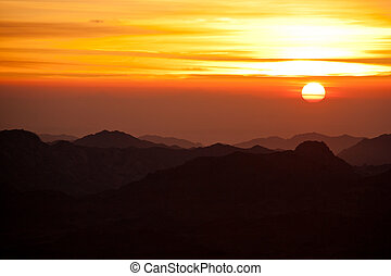 sinai desert with sand and sun rise in december with mountains a