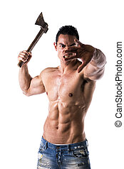 Aggressive, violent muscular young man with axe in his hand...