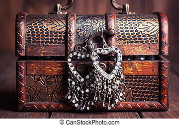 vintage earrings in a form of hearts hanging on old treasure...