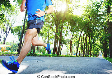 Young man running outdoors in the morning.