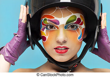 Young model with bright creative make up with helmet -...