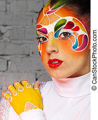 Beautiful young model with bright creative make up with...