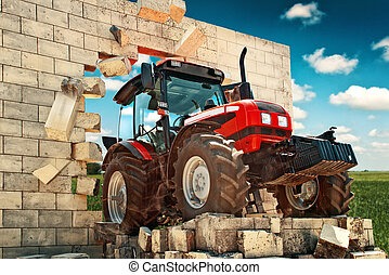 Brand new Tractor breaking through the wall