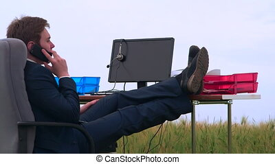 Young man working in his mobile office outdoors