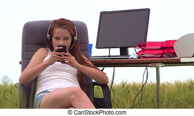 Young girl using smartphone to connect with friends in a...