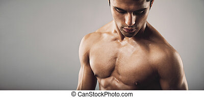 Portrait of fit masculine man looking down - Portrait of fit...
