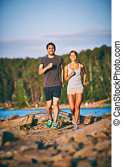 Energetic couple - Photo of happy couple running outdoors